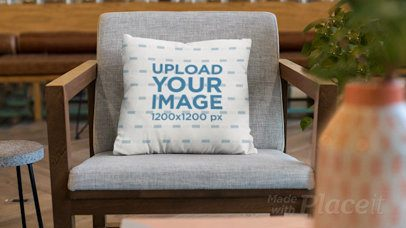 Parallax Video Mockup of a Pillow on an Elegant Wood Chair 26053