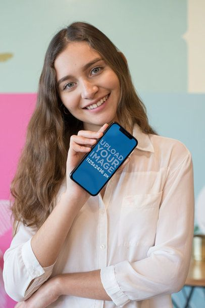Mockup of a Smiling Girl Showing an iPhone XS 25362