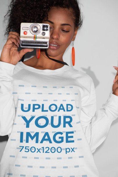 Crewneck Sweatshirt Mockup of a Girl Holding a Retro Instant Camera 21910