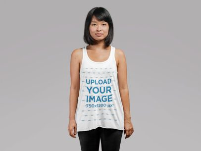 Mockup of a Young Woman Wearing a Loose Tank Top at a Studio 21732
