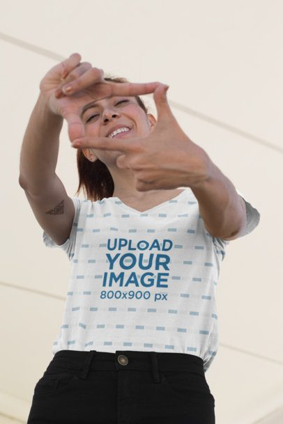 Sublimated V-Neck Tee Mockup of a Girl Framing Her Face with Her Fingers 24975