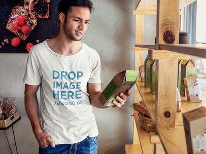 T-shirt Mockup Featuring a Young Man at an Organic Market 6504a
