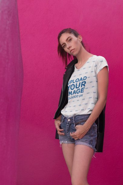 V-Neck T-Shirt Mockup of a Cool Girl Posing against a Pink Wall  24893