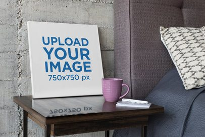 Mockup of an Art Canvas on a Wooden Table 25867