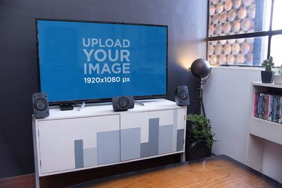Mockup of a Flat Screen Smart TV with a Sound System 25877
