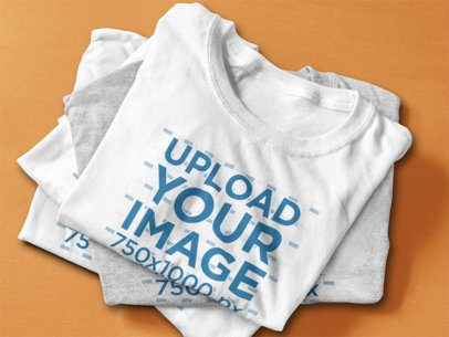 T-Shirt Mockup Featuring a Stack of Folded T-Shirts 6402a