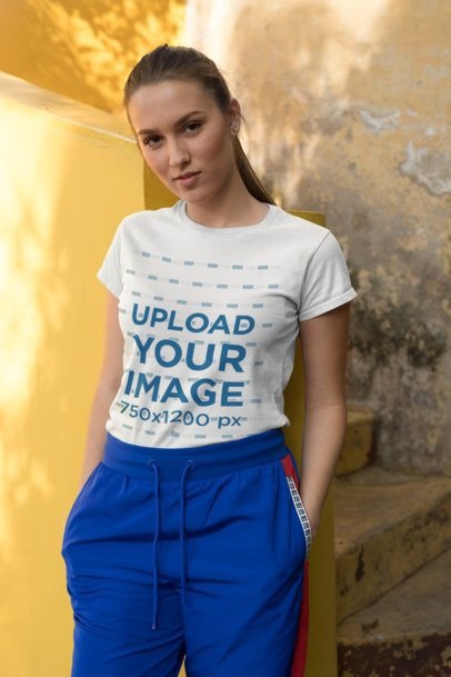 Tee Mockup of a Fashionable Girl Standing by an Old Stairway 26284