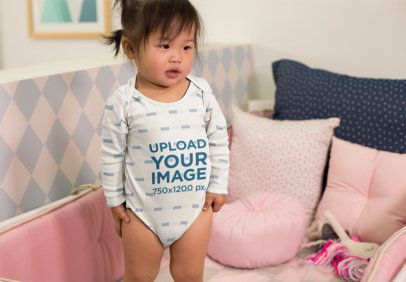 Mockup of an Adorable Baby Girl Wearing a Onesie in Her Crib 25135