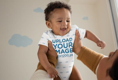 Onesie Mockup of a Joyful Baby Being Lifted by His Mother 25120