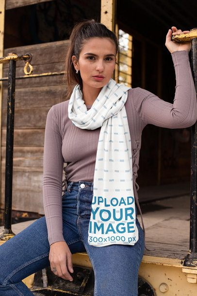 Scarf Mockup Featuring a Girl Sitting on the Edge of an Abandoned Wagon 25671