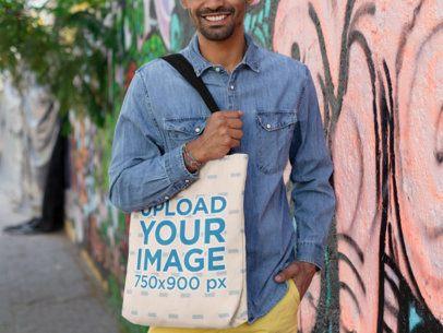 Tote Bag Mockup of a Smiling Man Wearing a Denim Shirt 26707