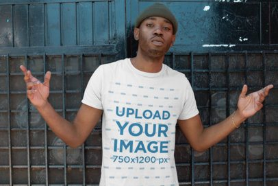 T-Shirt Mockup of a Serious-Faced Man with a Beanie Opening His Arms 26314