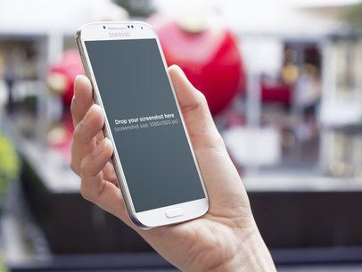 White Samsung Galaxy S4 Held By A Woman 2