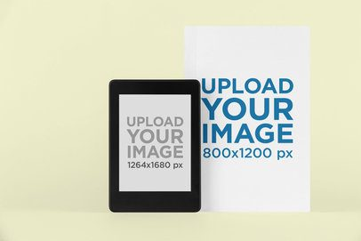 Mockup of a Kindle Paperwhite and a Physical Book Cover Against a Plain Surface 26469