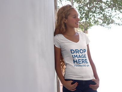 T-Shirt Mockup of a Young Blonde Woman Leaning Against a Wall 7805