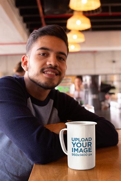 Mockup of a 21 Oz Mug over a Countertop Next to a Smiling Man 26938a