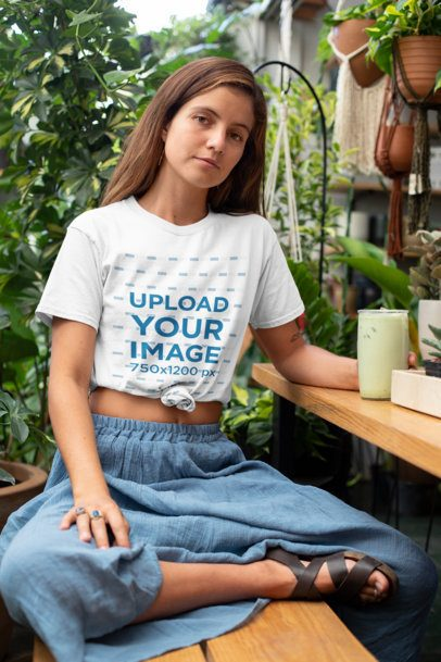 Knotted T-Shirt Mockup of a Woman at an Outdoor Restaurant 27082
