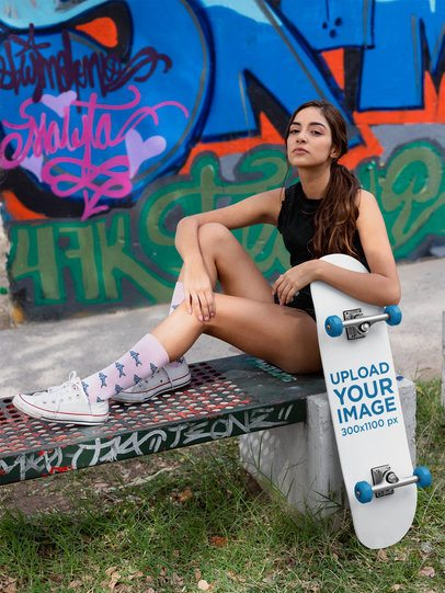 Skateboard Mockup Featuring a Daring Woman in Front of a Graffiti Wall 27115