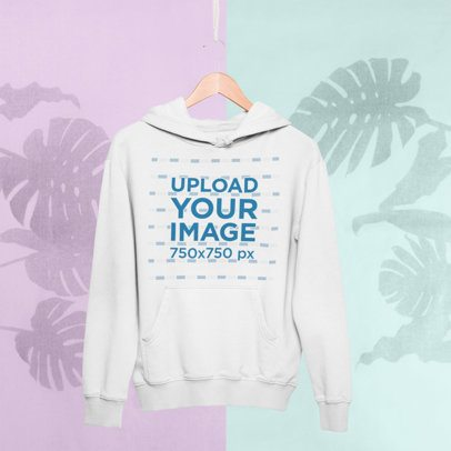 Mockup of a Hanger with a Pullover Hoodie Against a Tropical Surface 27019