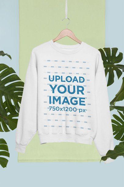 Crewneck Sweatshirt Mockup on a Hanger Against Palm Trees Clipart 27021