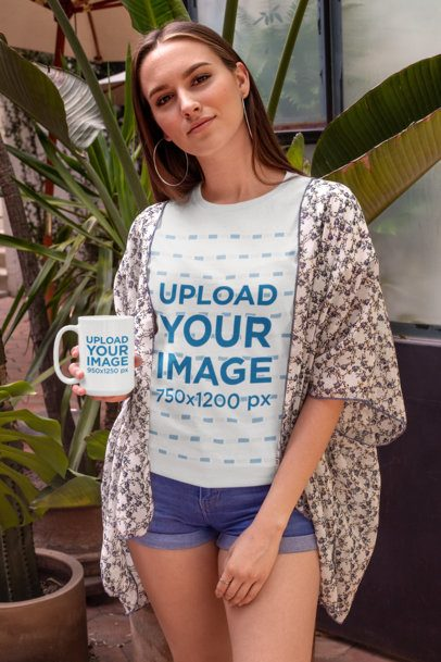 T-Shirt Mockup of a Woman with a Floral Overblouse Holding a 15 oz Mug 27510