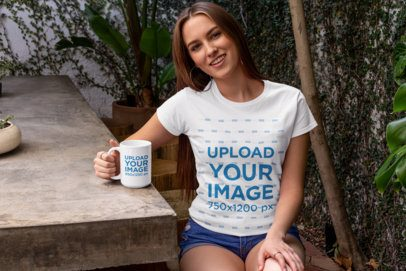 Mockup of a Long-Haired Woman Wearing a T-Shirt  and Holding a 15 oz Mug in Her Backyard 27511