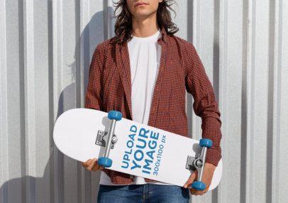 Mockup of a Rebel Man Holding a Skateboard 27201