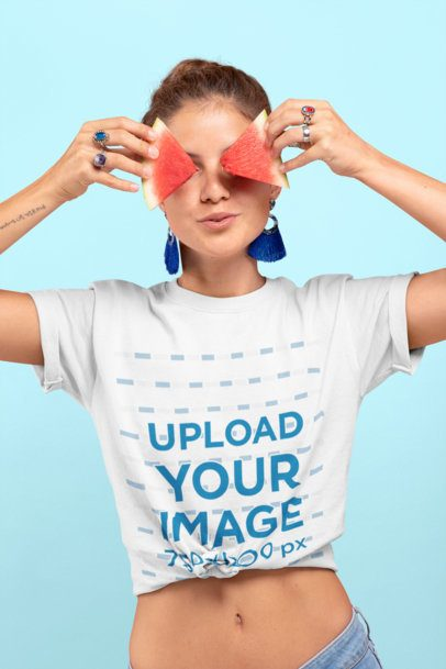 Knotted T-Shirt Mockup Featuring a Woman Covering Her Eyes with Two Watermelon Slices 27097