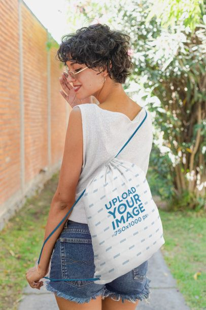 Drawstring Bag Mockup Featuring a Short-Haired Girl Looking over Her Shoulder 27573