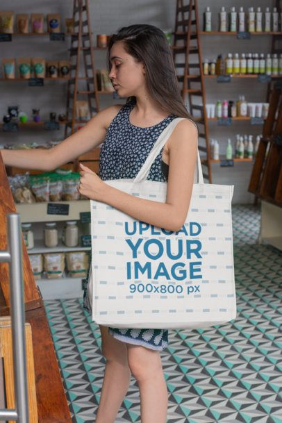 Mockup of a Woman Carrying a Grocery Bag Inside a Small Store 27623