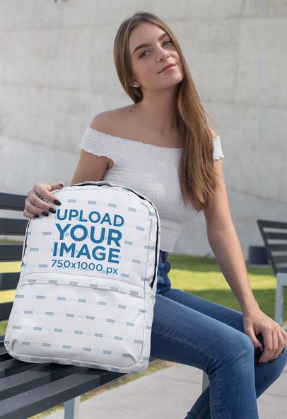 Backpack Mockup Featuring a Female Teen Sitting on a Bench 27708