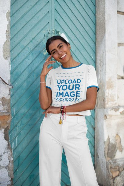 Ringer Tee Crop Top Mockup Featuring a Woman Outside an Old Building 27273