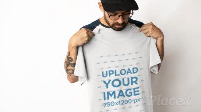 Video of a Bearded Man Holding a T-Shirt Against His Chest 13080