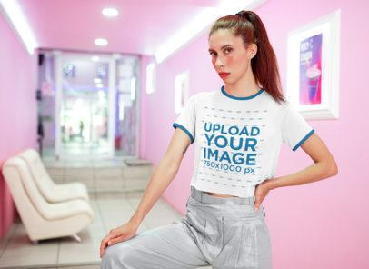 Crop Top Ringer T-Shirt Mockup Featuring a Woman in a Pink Hallway 27258