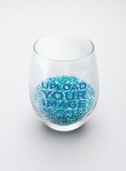 Mockup of a Stemless Wine Glass with Blue Glitter Inside 27935