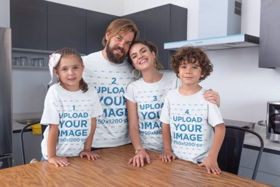 Mockup of a Family of Four Wearing T-Shirts at the Dining Room 28056