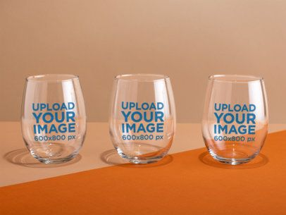 Mockup of Three Stemless Wine Glasses over a Bicolor Surface 27944