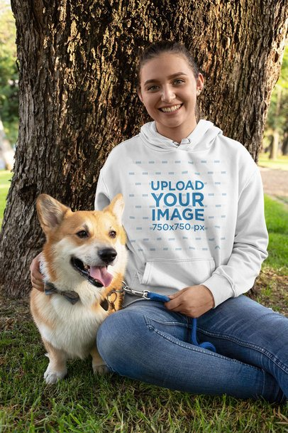 Pullover Hoodie Mockup Featuring a Woman and Her Dog Sitting by a Tree 28040