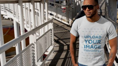T-Shirt Video of a Man Standing on a Pedestrian Bridge 12877