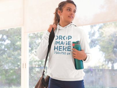Hoodie Mockup of a Young Woman Leaving a Yoga Class a8611