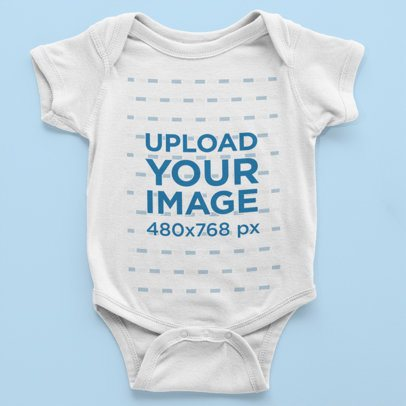 Mockup of a Little Baby's Onesie Over a Flat Surface 222-el