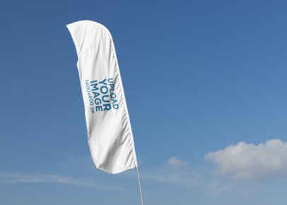 Mockup of a Flag Banner Against a Blue Sky 28030