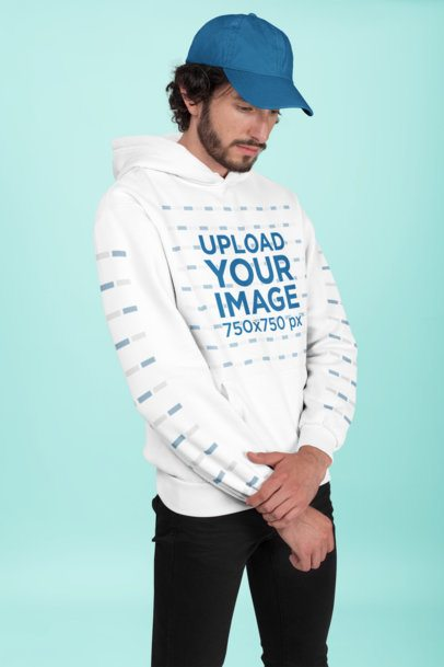 Pullover Hoodie Mockup of a Man Wearing a Cap 28318
