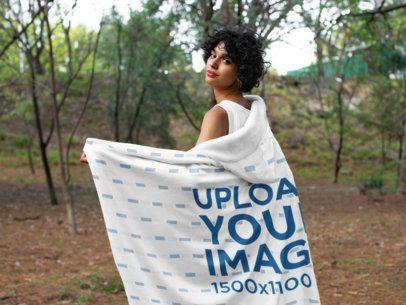 Hooded Blanket Mockup of a Woman Walking in the Woods 28136