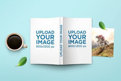Mockup of an Open Softcover Book Lying Upside Down Next to a Coffee 302-el