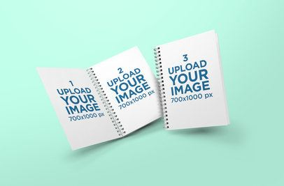 Mockup of Two A5 Spiral Notebooks Falling Into a Customizable Backdrop 307-el