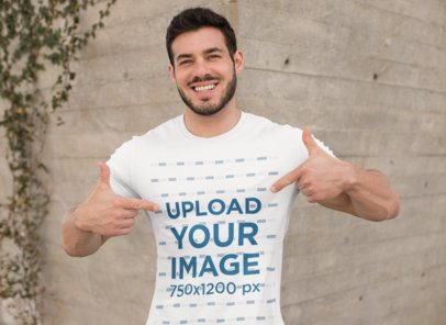 Mockup of a Muscular Man Pointing at His T-Shirt 28519
