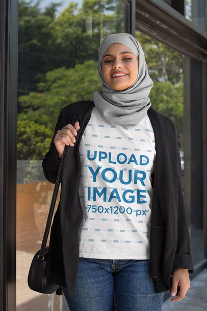 T-Shirt Mockup of an Elegant Woman Wearing a Hijab and Carrying a Purse 28405