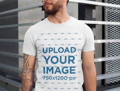 Heathered T-Shirt Mockup Featuring a Man with Tattoos on One Arm 28616
