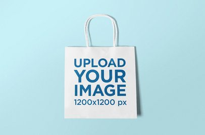 Mockup of a Squared Gift Bag Lying Flat on a Colored Background 650-el